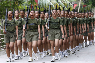 Newly recruited female marine soldiers march during a military drill inside the marine barracks in Cavite city