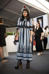 A woman is photographed at Lincoln Center during New York Fashion Week