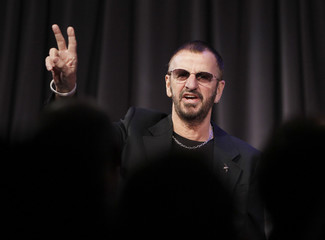 Former Beatles drummer Ringo Starr receives a standing ovation in Los Angeles