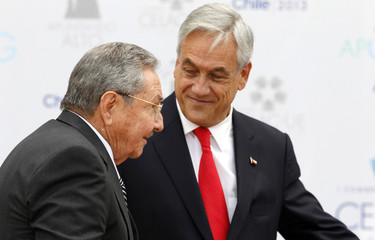 Cuba's President Raul Castro is welcomed by Chile's President Sebastian Pinera to the summit of the Community of Latin American, Caribbean States and European Union (CELAC-UE) in Santiago