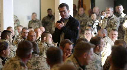German Defence Minister Karl-Theodor zu Guttenberg talks to German Bundeswehr army soldiers before lunch during a visit to their camp in Kunduz