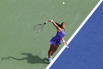Marion Bartoli of France serves to Jamie Hampton of the U.S. during their women's singles match at the U.S. Open tennis tournament in New York