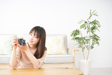 Young woman using her camera