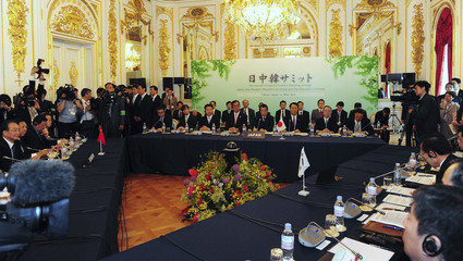 Japan's PM Kan, Chinese Premier Wen and South Korean President Lee attend a trilateral summit in Tokyo