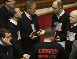 Members of the Batkivshchyna (Fatherland) bloc, wearing shirts with a portrait of imprisoned former prime minister Yulia Tymoshenko, talk before the first session of newly-elected Ukrainian parliament in Kiev