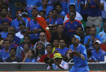 India's Rahane celebrates after catching out Australia's batsman Maxwell during their Cricket World Cup semi-final match in Sydney