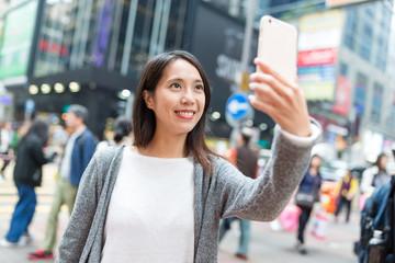 Woman taking selfie in Mongkok