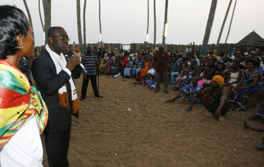 Gervais Coulibaly , spokesman for Ivorian President Laurent Gbagbo, speaks to the Rastafari community in the Rasta village of Port Bouet