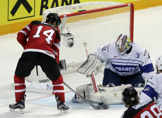 France's goaltender Quemener defends against Canada's Eberle during their Ice Hockey World Championship game in Prague