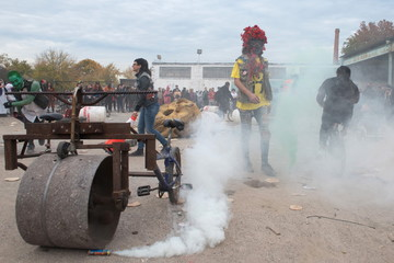 """Participants are seen through smoke during """"Bike Kill 12"""" in the Brooklyn borough of New York City"""