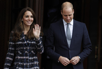 Britain's Prince William and his wife Catherine, Duchess of Cambridge, leave after attend a ceremony for VC recepients in Manchester