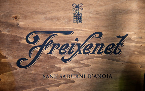 The Freixenet logo is displayed in a wine shop in Alella