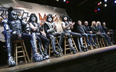 Members of Kiss and Def Leppard are seen on stage during an announcement that the bands will team up this summer for a 42-city North American tour, at the House of Blues in West Hollywood, California