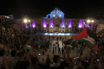 Members of the Palestinian band Al-Ashiqeen perform as they sing Palestinian national songs during the Jerash Festival in the ancient city of Jerash