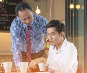 Businessman working on a tablet,meeting in coffee shop