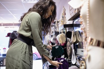 Woman selecting accessories in jewelry section