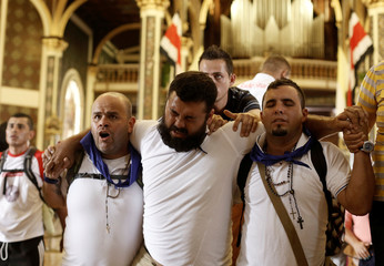 People complete the last steps of their pilgrimage to the Virgin of Los Angeles on their knees, inside the Basilica of Los Angeles during a celebration of the Virgin of Los Angeles in Cartago, Costa Rica