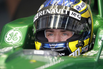 Caterham Formula One driver Pic sits in his car during the first practice session of the Bahrain F1 Grand Prix at the Sakhir circuit