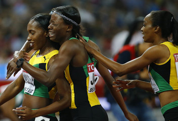 The Jamaican team celebrates after competing in the women's 4 x 400 metres relay final during the 15th IAAF World Championships at the National Stadium in Beijing