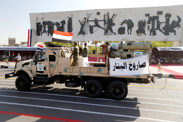 Vehicles of the Hashid Shaabi (Popular Mobilization) take part in a military parade at Tahrir Square in central Baghdad