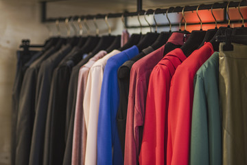 Women boutique shop concept - colorful clothing on hangers.