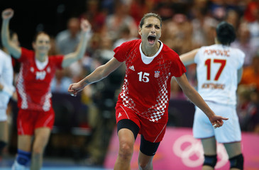 Croatia's Andrea Penezic celebrates a goal against Montenegro in their women's handball Preliminaries Group A match at the Copper Box venue during the London 2012 Olympic Games