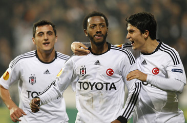 Besiktas' Manuel Fernandes celebrates with teammates Pektemek and Uysal after scoring a goal against Stoke City during their Europa League Group E soccer match at Inonu stadium in Istanbul