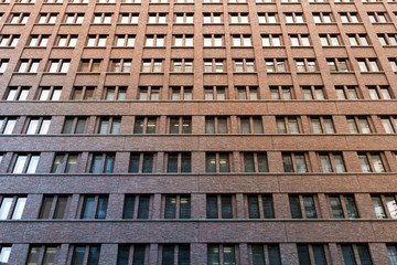 high rise brick building facade - window pattern