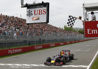 Red Bull Formula One driver Ricciardo of Australia takes the checkered flag to win the Canadian F1 Grand Prix at the Circuit Gilles Villeneuve in Montreal
