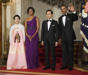 U.S. President Obama and his wife stand with South Korean President Lee and his wife at a state dinner in the White House