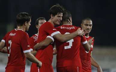 Switzerland's players celebrate after scoring a goal against Tunisia during their international friendly soccer match in Sousse