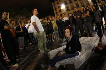Supporters of a movement that protests against the ongoing financial crisis, politicians and bankers sit-in as they camp in a main square in Malaga