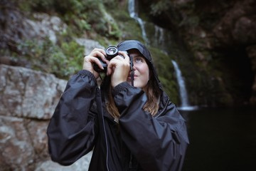 Woman taking picture from camera