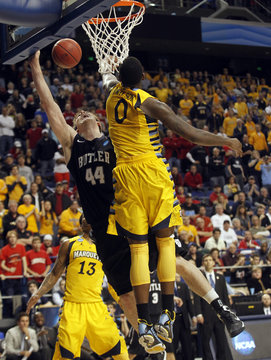Butler University's Andrew Smith fights to get his shot off under pressure from Marquette University's Jamil Wilson during their third round NCAA basketball game in Lexington