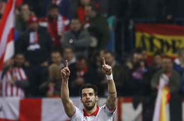 Sevilla's Negredo celebrates his goal during their Spanish King's Cup semi final first leg soccer match against Atletico Madrid in Madrid