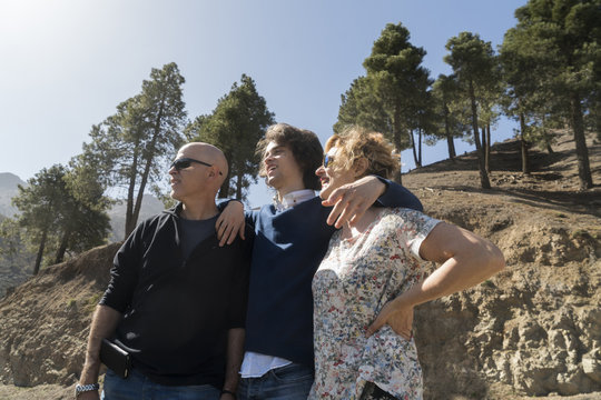 Morocco, Marrakesh, family with adult son standing together