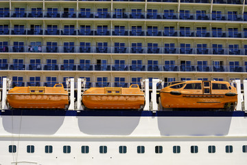 Big cruise ship docked in a sea port. View lifeboat rescue