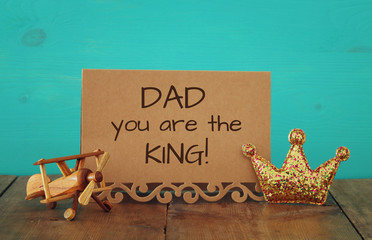 greeting card, plane toy and glitter king crown. Father's day concept