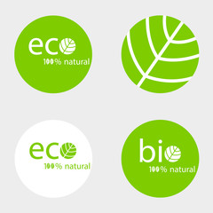 A set of round green labels with eco and bio inscriptions