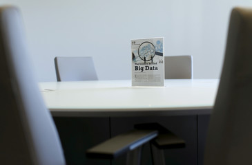 A sign sits on a table in a conference room during the opening of a data lab by information services company Experian in San Diego,