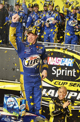 Keselowski celebrates clinching the Sprint Cup after climbing from his number 2 Dodge during the Ford EcoBoost 400 Sprint Cup NASCAR race in Homestead