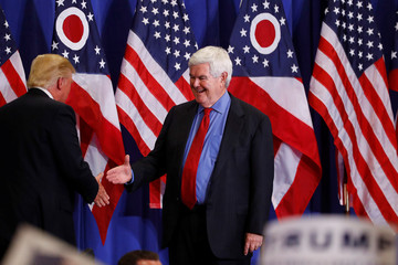Former Speaker of the House Newt Gingrich greets U.S. Republican presidential candidate Donald Trump at a rally at the Sharonville Convention Center in Cincinnati, Ohio