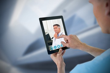 Composite image of male nurse using digital tablet