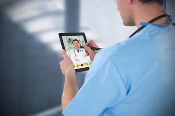 Composite image of surgeon using digital tablet