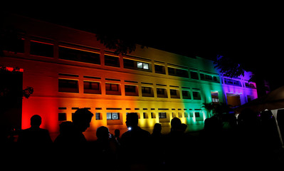 The U.S. Embassy building is illuminated in rainbow colours to commemorate International Gay Pride Day and also as a tribute to the victims of the Orlando nightclub shooting, in San Jose, Costa Rica