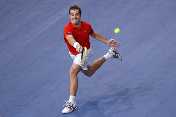 Gasquet of France returns the ball to Anderson of South Africa during the Paris Masters tennis tournament in Paris