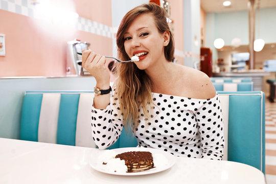 Pretty girl in an american restaurant