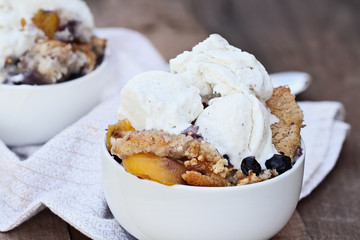Blueberry and Peach Cobbler with Ice Cream