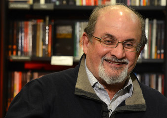 Author Salman Rushdie gestures during an interview with Reuters in central London