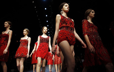Models display creations  from Dolce&Gabbana's  Autumn/Winter 2013 collection at Milan Fashion Week